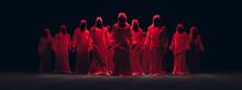 3D Rendering, Illustration Of Several Red Hooded Figures In A Dark Background