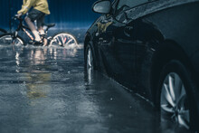Car In A Deep Puddle. Downpour In The City. Flooded Car. Flood In The City.