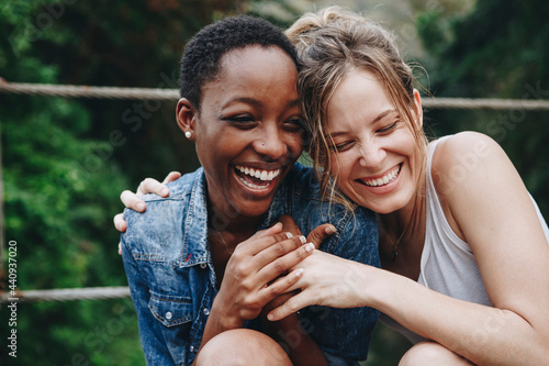 Fotografie, Obraz Two girl friends laughing and embracing each other
