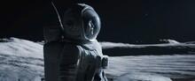 Portrait Of Asian Lunar Astronaut Opens His Visor While Exploring Moon Surface