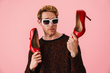 Stylish Young White Man Gay Showing High Heel Red Shoes
