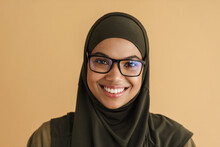 Black Muslim Woman In Hijab Smiling And Looking At Camera