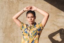 Ethnic Woman In Shirt With Floral Ornament In Sunlight