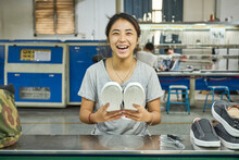 Employee Doing Quality Control In Chinese Shoes Factory