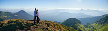 Side View Of Romantic Couple Relaxing On Fresh Air With Incredible Landscape. Concept Of Harmony With Nature. Panorama