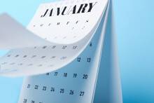 Flip Calendar With Page Of January On Color Background, Closeup