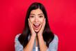 Leinwandbild Motiv Portrait of attractive cheerful amazed impressed girl enjoying sale news isolated over bright red color background