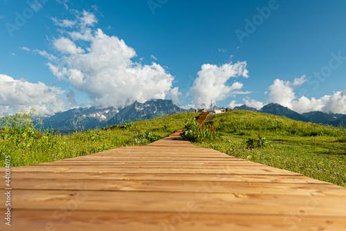 Obraz na plátně wooden boardwalk in the mountains leading to the observation deck hills