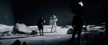 WIDE Behind The Scenes, Cinematographer Shooting Viral Video For Social Account On A Large Moon Landing Set. Virtual Production With LED Screens