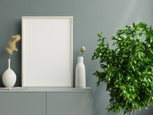 Mockup Photo Frame On The Dark Green Cabinet With Beautiful Plants.