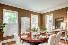 Spacious Dining Room Interior With Tasteful Furniture.