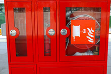 Selective Focus Fire Extinguisher Cabinets Used In Subway Stations And Factories And Fire Extinguisher Hose Inside