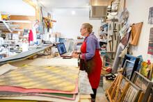 Woman Working On Laptop In Art Studio