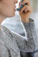 Close Up Woman With Asthma Using Inhaler
