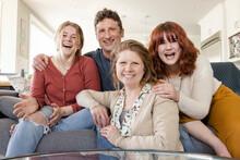 POV Portrait Happy Family Video Chatting On Living Room Sofa