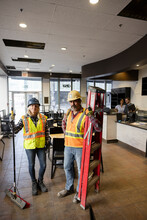 Construction Workers In Newly Renovated Cafe