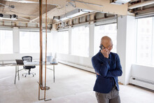 Man On Phone In Office Ready To Be Remodelled