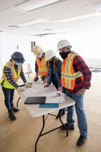 Construction Team Having A Planning Meeting