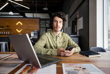 Portrait Confident Creative Businessman With Smart Phone In Office