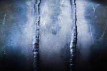 Two Vertical Welding Seams On A Steel Pipe, Close-up.