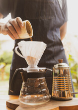 Barista Making Coffee Pouring Coffee Powder On Paper Filter On Top Of Glass Coffee Jar. Brazilian Organic Artisanal Bakery Small Business Concept.