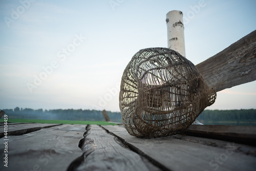 Stampa su Tela Fishing cage trap on the old wooden pier background.