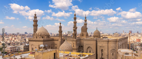 Canvas Aerial day shot of minarets and domes of Sultan Hasan mosque and Al Rifai Mosque