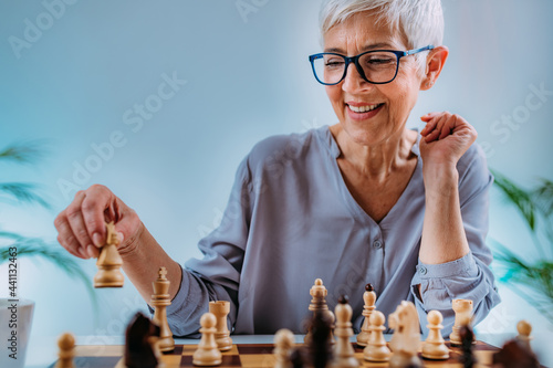 Cognitive Rehabilitation Activity. Senior Woman Playing Chess. Fototapet