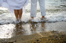 Couple On The Seashore Stand In The Water