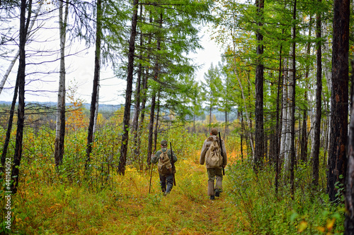 Fotografie, Obraz Hunters go hunting in the forest