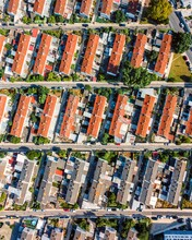 Aerial View Of A Residential Area With Buildings Forming A Geometric Pattern In Carnide, Lisbon, Portugal.