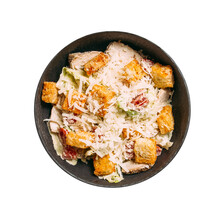 Isolated Black Bowl Of Caesar With Croutons And Chicken