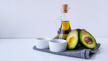 Olive Oil In Glass Bottle With Sesame And Flax Seeds. Fresh Ripe Hass Avocado. Healthy Eating.