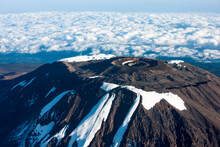 Aerial View Of Snowcapped Mountains Against Sky. Mount Kilimanjaro .