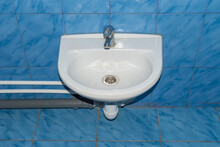 The Sink Is White With A Faucet For Small Dentes.