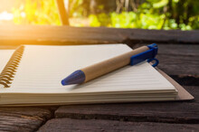 Pen , Notebook On A Wooden Table