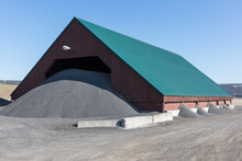 Barn And Gravel Pile Used For Road Construction And Maintenance