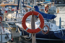 Close-up Of Lifebelt On Pole At Harbor