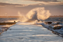 A Weather Storm, Waves Crashing Over A Waterfront