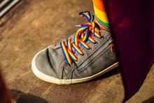 High Angle View Of Shoe With Rainbow Colored Laces On Floor