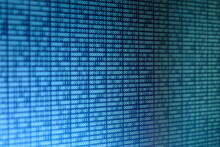 Close-up Of Binary Code On Screen