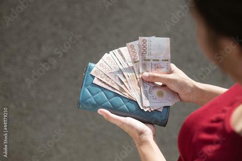 Fototapeta Thai baht cash on hand, foreign exchange, Thai baht exchange for business,busine