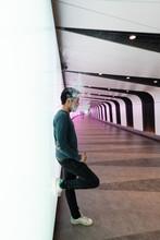 Man In Modern Pedestrian Tunnel With LED Illumination