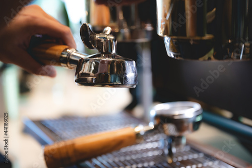 Canvas professional barista making espresso coffee to a drink cup in cafe, beverage caf