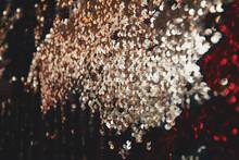 Full Frame Shot Of Sequins With Dark Background
