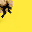 Leinwandbild Motiv Hat on yellow background, top view with space for text. Sun protection accessory