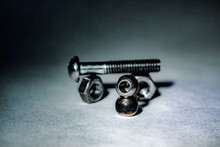 High Angle View Of Nuts And Bolt Against White Background