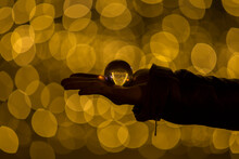 Bokeh Of A Person Holding A Crystal Ball