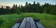 Green Mountains Landscape. Sunset Over The Hill. Mountains Landscape Panorama. Old Bench On The Green Hill.