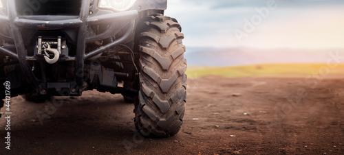 Fotografie, Obraz Banner motocross background, ATV wheels quad bike on desert offroad dust